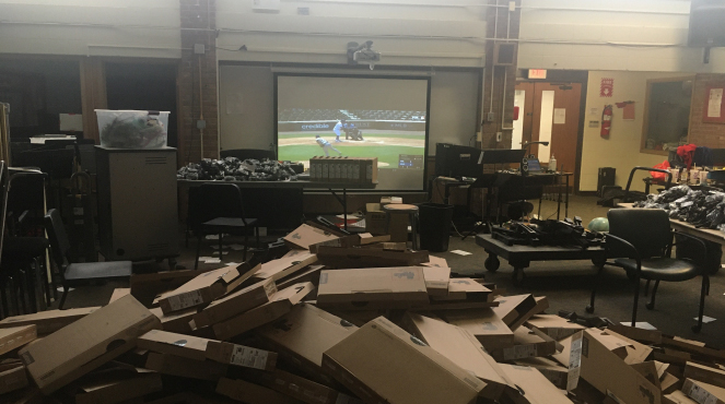 Chrome books being unpacked while watching the Cubs/Brewers game.